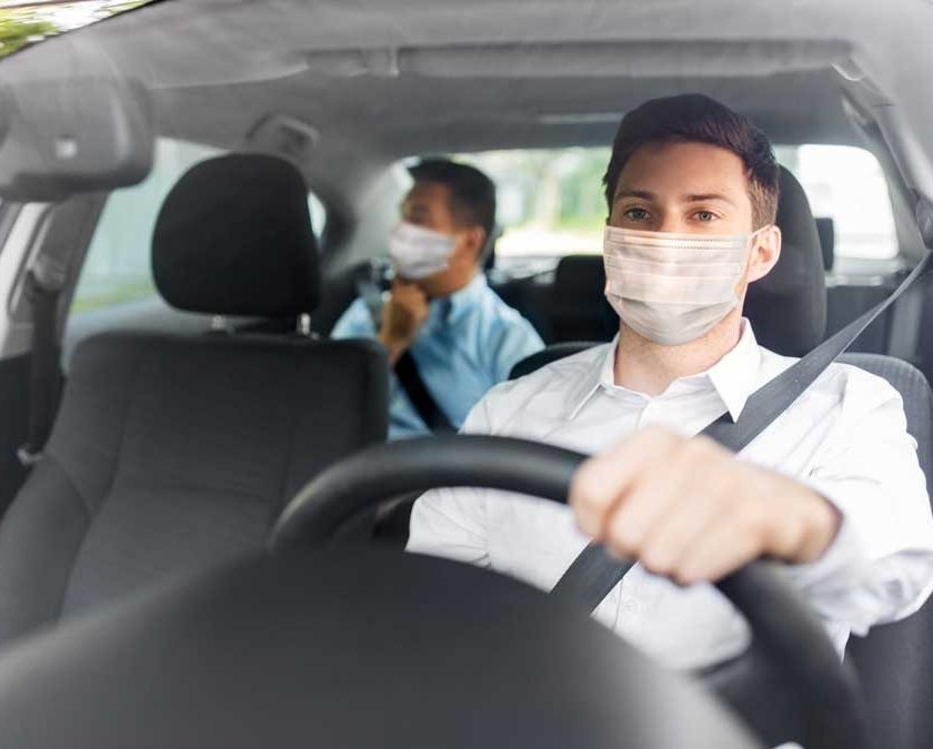 Agape driver wearing a mask and supplying a client with non-emergency medical transportation.